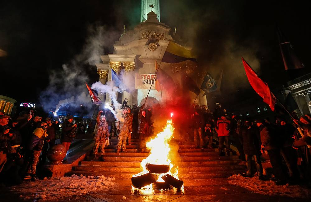 Ukrainian nationalists burn tires during a rally to mark the third anniversary of the Euromaidan Revolution on the Independence Square in Kiev, Ukraine, November 21