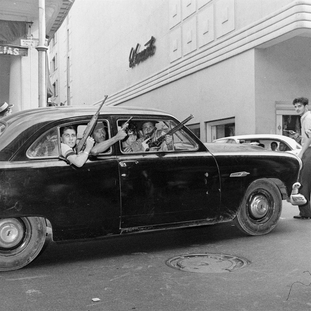 Rebels in the car on Havana's street ahead of inaugurating a revolutionary government, January 2, 1959