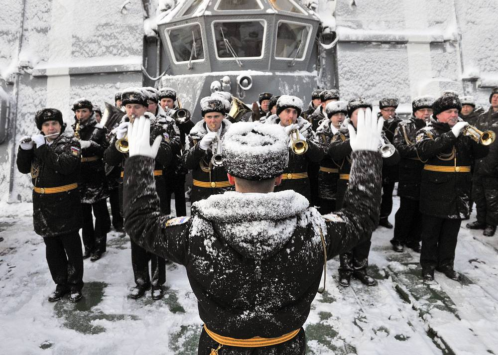 A military band performs at a ceremony to welcome the Vice-Admiral Kulakov large anti-submarine ship at the base in Severomorsk after the Mediterranean mission