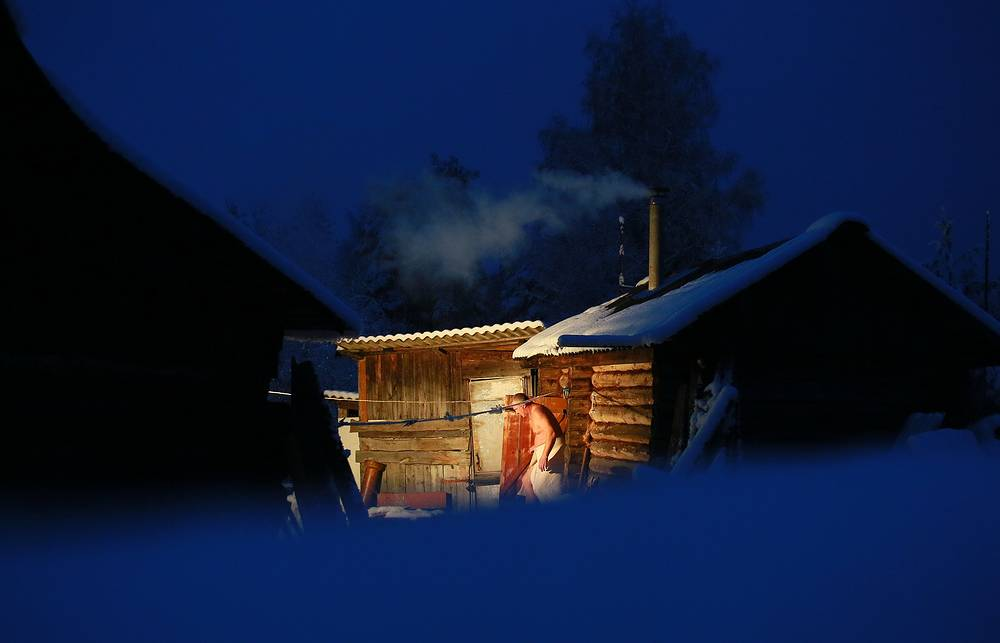 A man prepares a Russian banya (a Russian type of sauna) in the village of Gorino, January 9