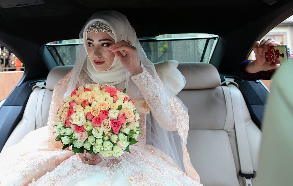The bride in her car during a traditional Chechen wedding ceremony, 