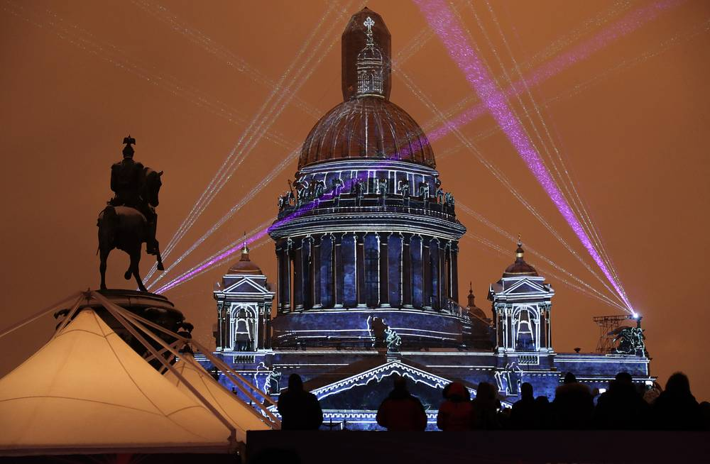 The cathedral was managed by the Imperial Ministry of Communication Routes and Public Buildings until 1871 and was then turned over to the Interior Ministry of the Russian Empire. Photo: A light show projected on the St. Isaac's Cathedral during a Festival of light