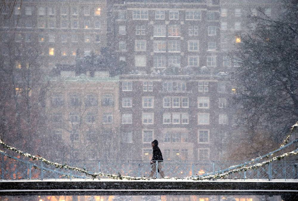 A person crosses the pedestrian bridge during a winter storm in Boston, USA, January 7, 2017
