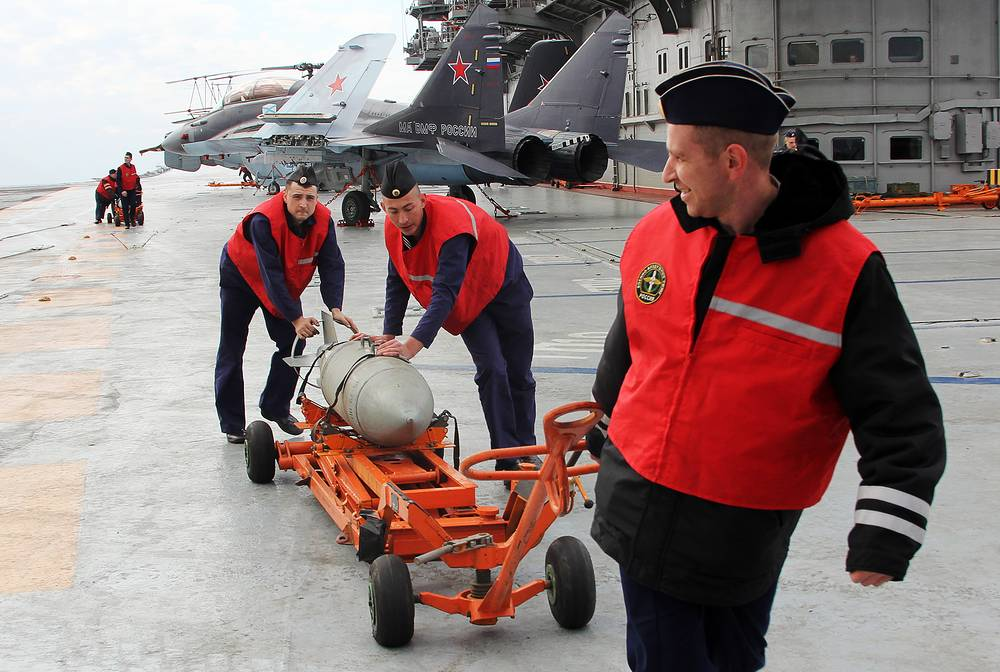 Russian servicemen with a bomb on Admiral Kuznetsov aircraft carrier, December 17, 2016
