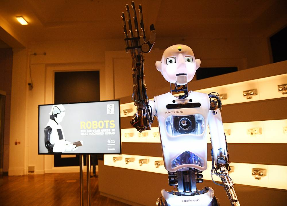 Robothespian, a social robot, interacts with visitors of 'Robots' exhibition at the Science Museum in London, Britain