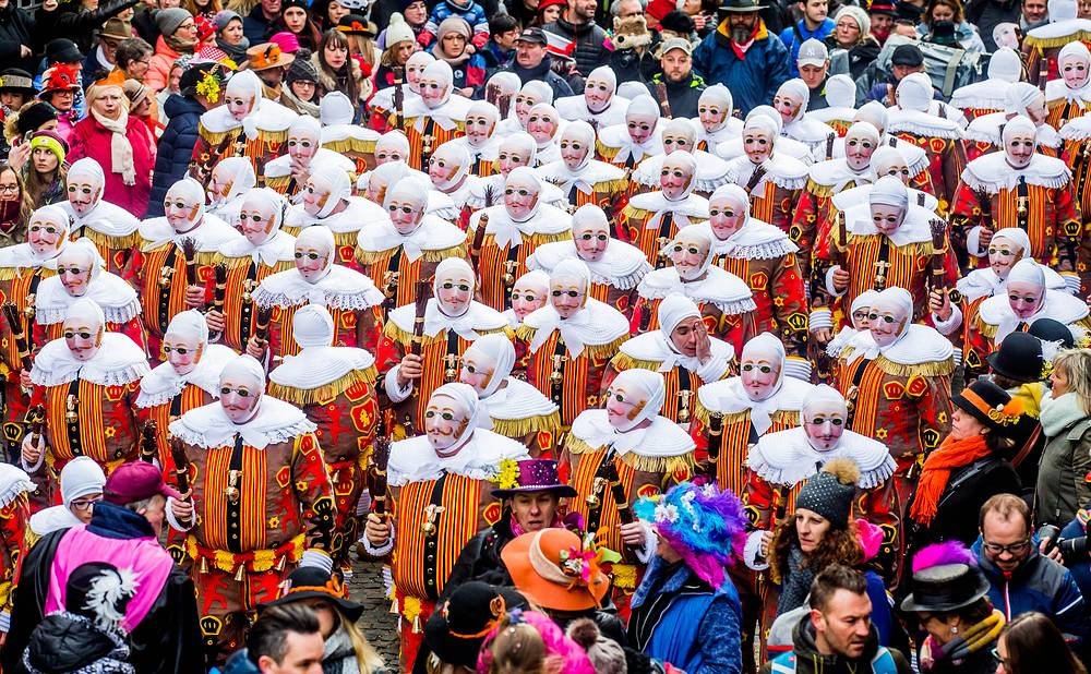 Festival participants known as Gilles wear traditional costumes during Carnival celebrations in the streets of Binche, Belgium, February 28