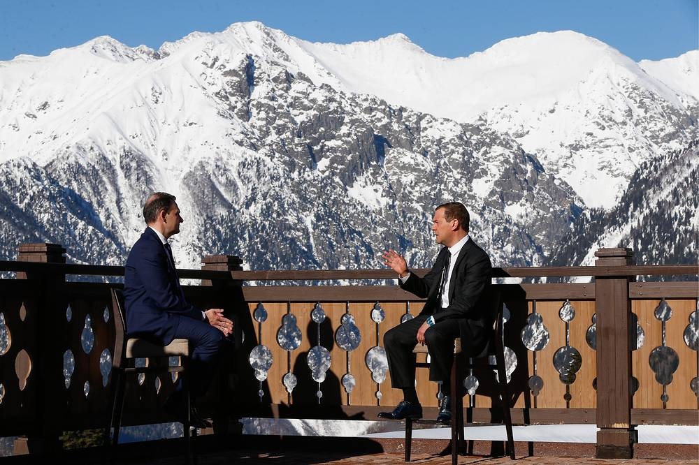 Rossiya 1 TV Channel journalist, Sergei Brilev and Russia's Prime Minister Dmitry Medvedev during an interview in Sochi, February 28