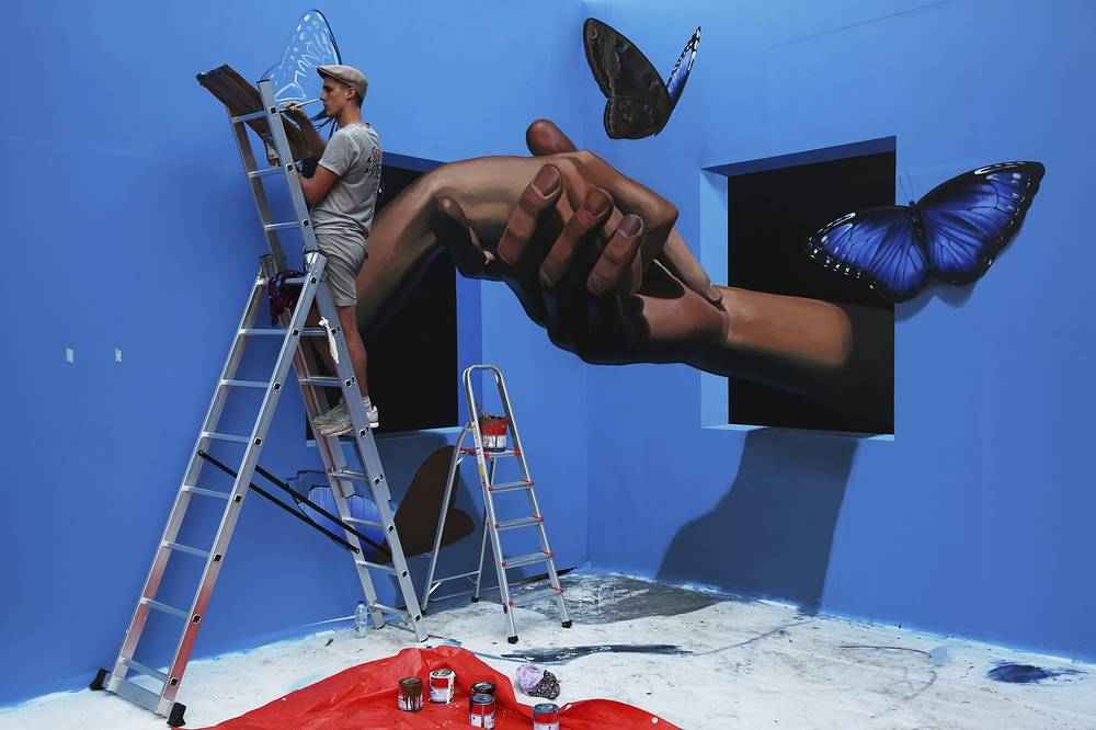 Danila Shmelev, an artist from Moscow, Russia, works on a 3-D picture in Dubai, United Arab Emirates, February 27