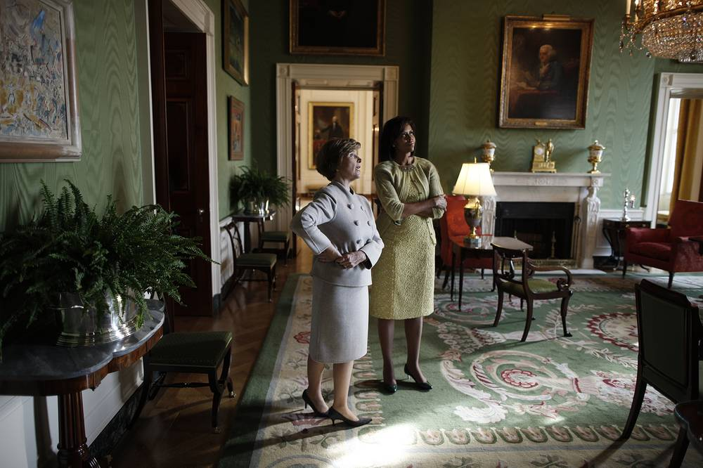 Furniture, fixtures, and decorative arts could now be declared either historic or of artistic interest by the President. This prevented them from being sold. Photo: First Lady Laura Bush takes Michelle Obama for a private tour of the artwork in the East Wing (Green room) of the White House, 2009