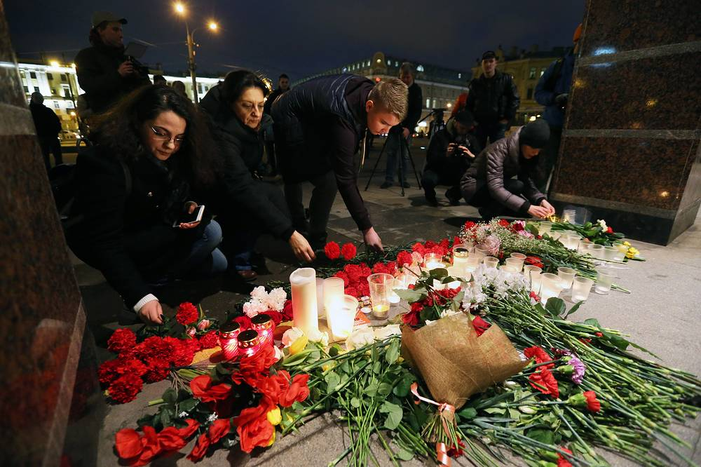 People honouring the victims of the St Petersburg metro blast at Spasskaya station, Saint Petersburg