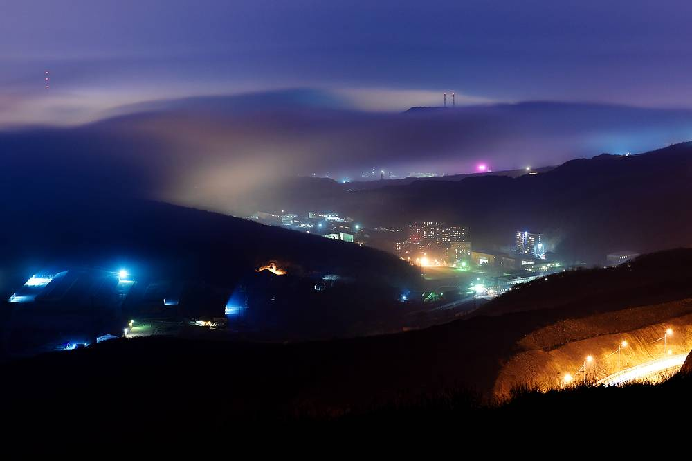 Mist over Vladivostok at night as fog settles over the Russian Pacific Coast, Russia, April 5