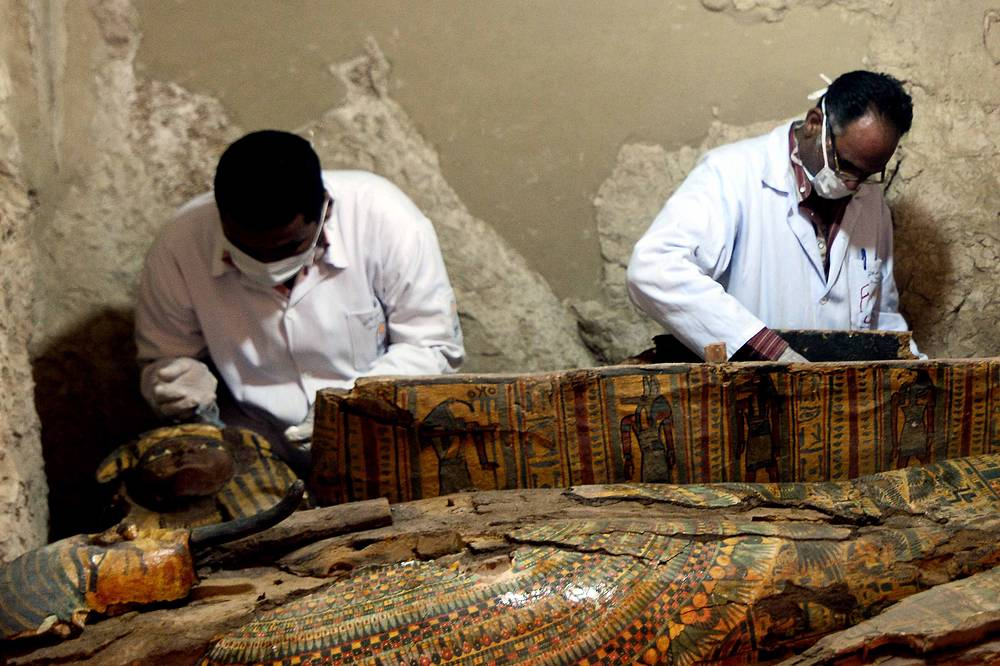 Egyptian archaeologists document the content of a recently discovered tomb at the Dra' Abu el-Naga' necropolis in Egypt