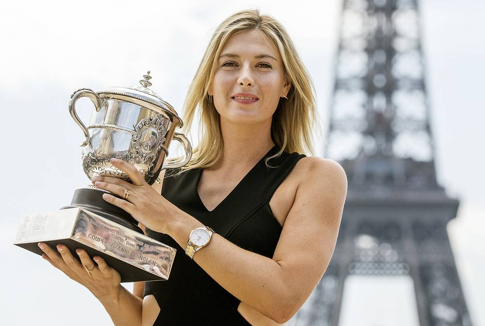 Maria Sharapova poses in front of the Eiffel Tower with her trophy for winning the women's final of the French Open in Paris, 2014