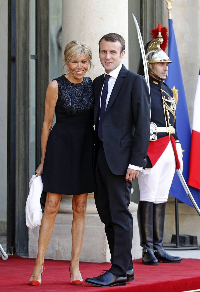 Then France's Economy Minister Emmanuel Macron and his wife Brigitte arrive at the Elysee Palace in Paris, 2015