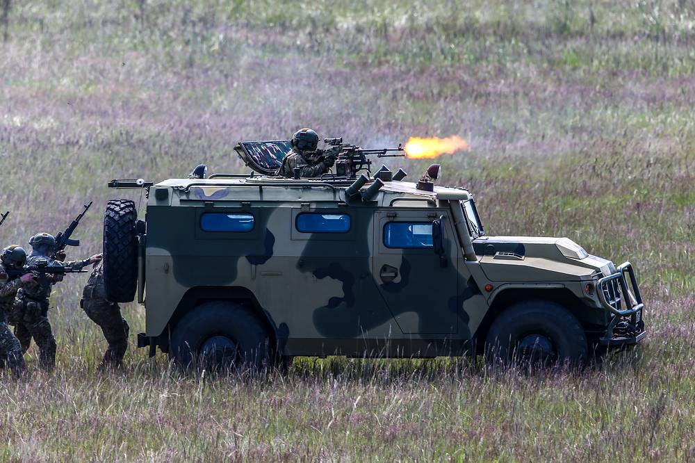 Russian servicemen in a Tigr multipurpose infantry mobility vehicle