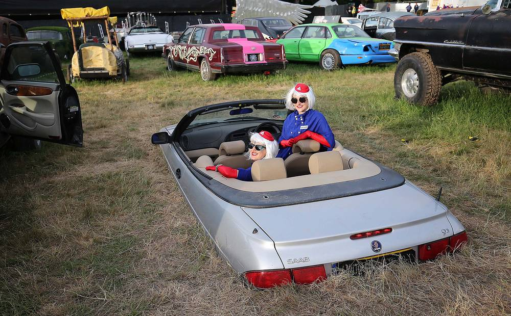 People pose in a convertible at the Cinemageddon event as part of the Glastonbury Festival of Contemporary Performing Arts 2017 at Worthy Farm, Somerset, Britain, June 22