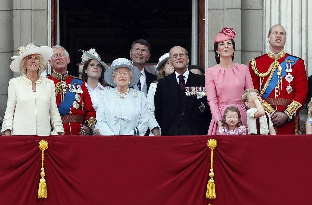 Members of Britain's Royal family, Camilla, the Duchess of Cornwall, Prince Charles, Princess Eugenie, Queen Elizabeth II, Timothy Laurence, Princess Beatrice, Prince Philip, Kate, the Duchess of Cambridge, Princess Charlotte, Prince George and Prince William watch a fly past as they appear on the balcony of Buckingham Palace, after attending the annual Trooping the Colour Ceremony in London, UK, June 17