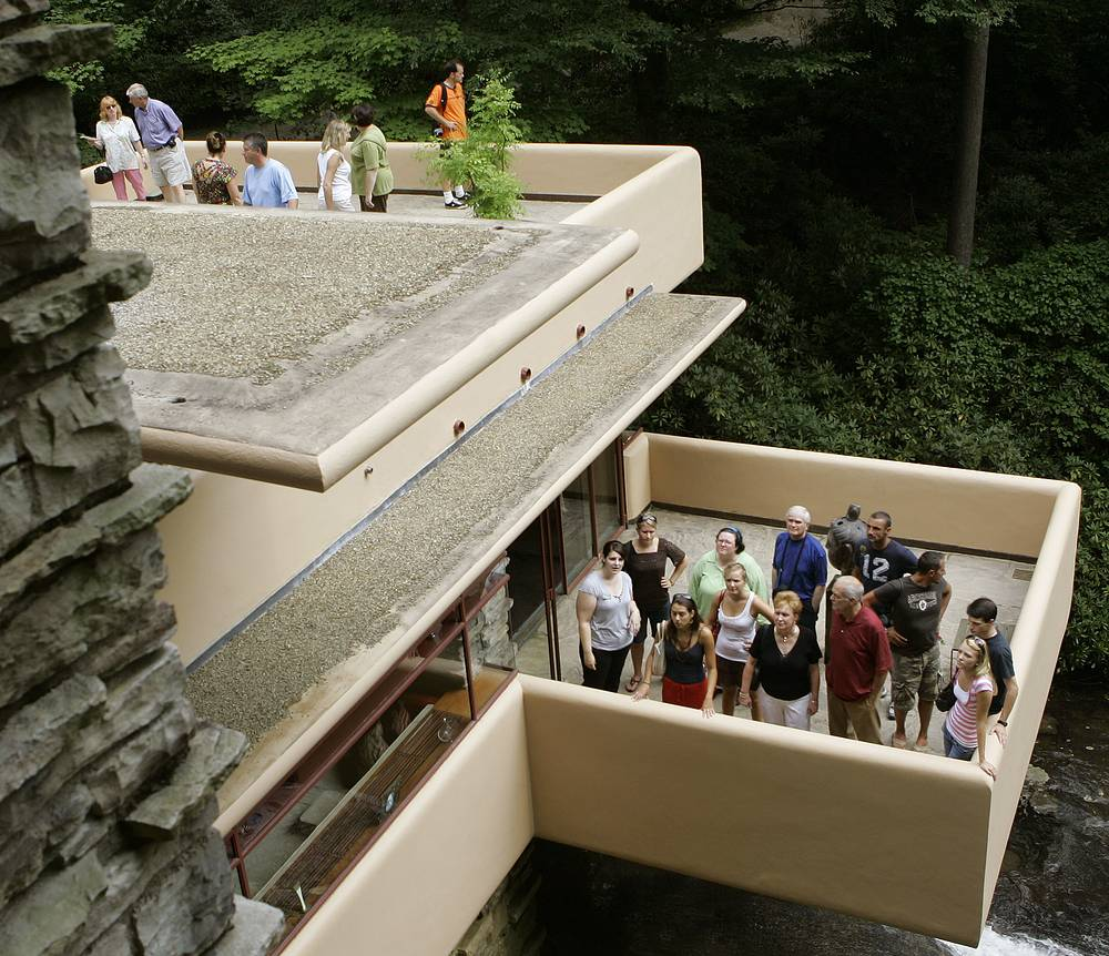 Visitors stand on the concrete terraces in Fallingwater house