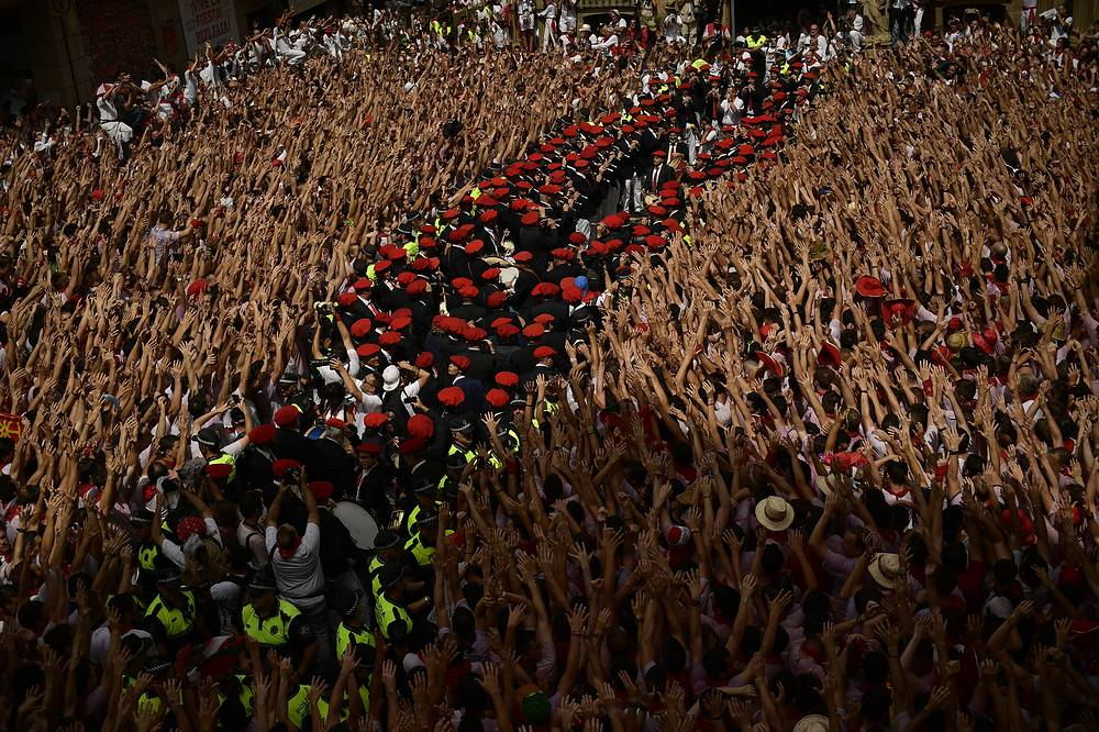 A municipal musical band prepare while revellers celebrate the official opening of the 2017 San Fermin Festival in Pamplona, Spain