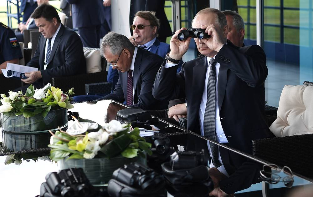 Russia's President Vladimir Putin looks through field glasses while attending the MAKS-2017 International Aviation and Space Salon in Zhukovsky, Moscow region, July 18