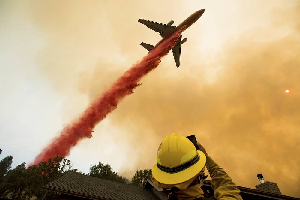 An air tanker drops retardant while battling a wildfire near Mariposa, California, USA, July 19