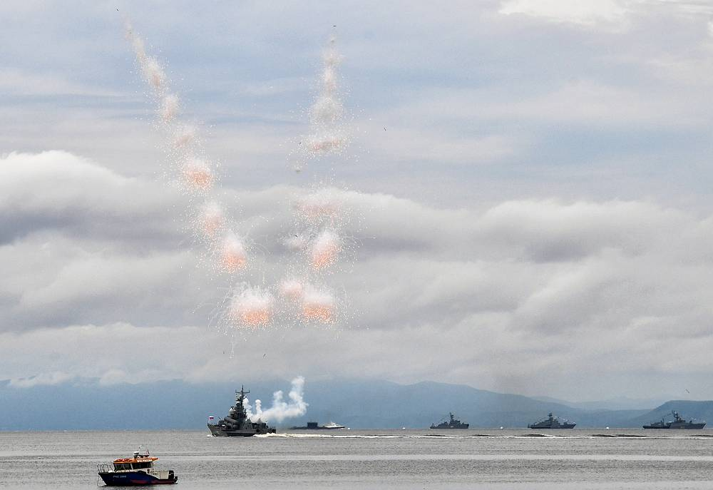 A missile boat releases a smoke screen in the Amur Bay waters