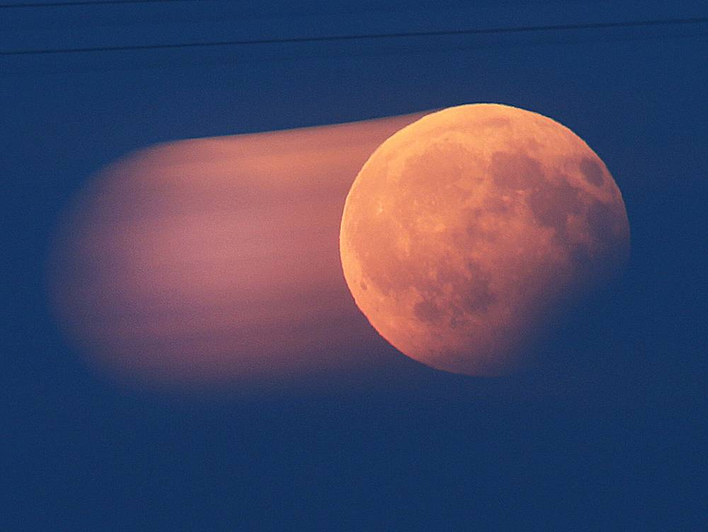 Picture taken with long exposure time shows the rising full moon during a partial lunar eclipse over Frankfurt, Germany