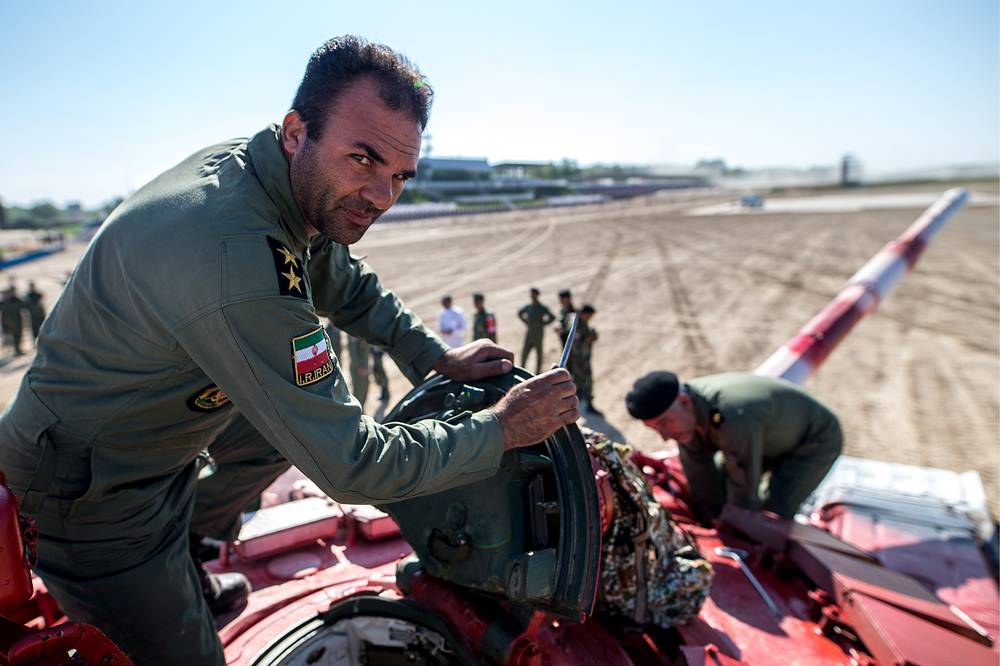 Iran's tank crew seen ahead of a relay race during the Tank Biathlon semifinal event as part of the 2017 International Army Games, at Alabino shooting range