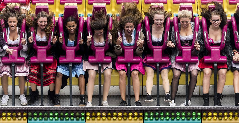 Visitors sit in a leisure ride at the fairground during the opening of the 184rd edition of the annual traditional Oktoberfest beer and amusement festival in Munich, Germany, September 16