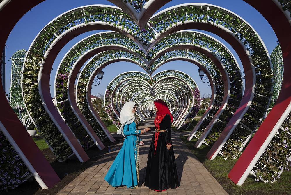 Muslim women attend the opening of a flower park as part of celebrations marking Day of Chechen Woman in the city of Grozny, Chechnya, September 17