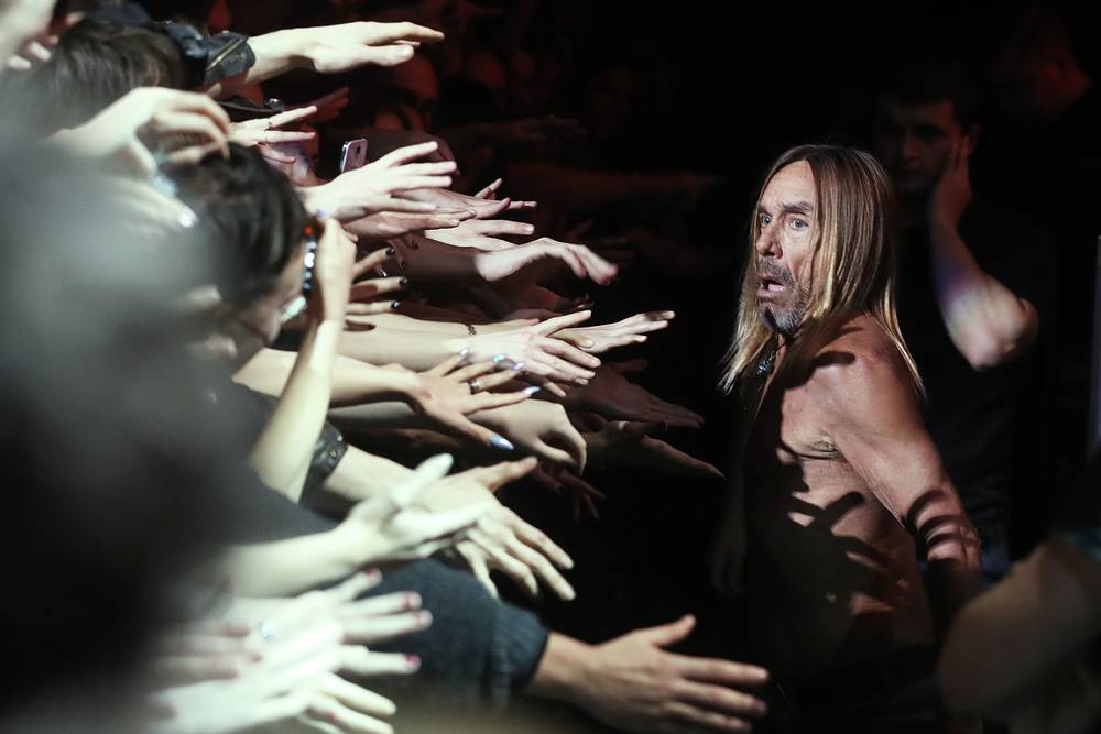 "American punk rock musician Iggy Pop greets his fans during a concert in Moscow's Stadium Live in support of his latest album titled ""Post Pop Depression"", October 19"