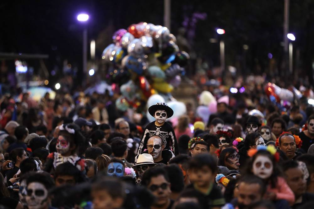 """People march in the Grand Procession of the """"Catrinas,"""" part of upcoming Day of the Dead celebrations in Mexico"""