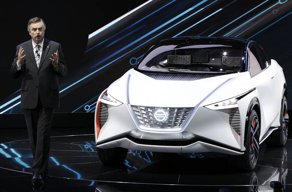 Daniele Schillaci, head of Nissan's global sales and marketing division, presents a Nissan IMx EV concept car