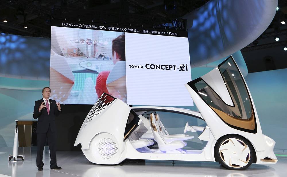 Didier Leroy, executive vice president of Toyota Motor Corporation, presents a Toyota Concept-i concept car