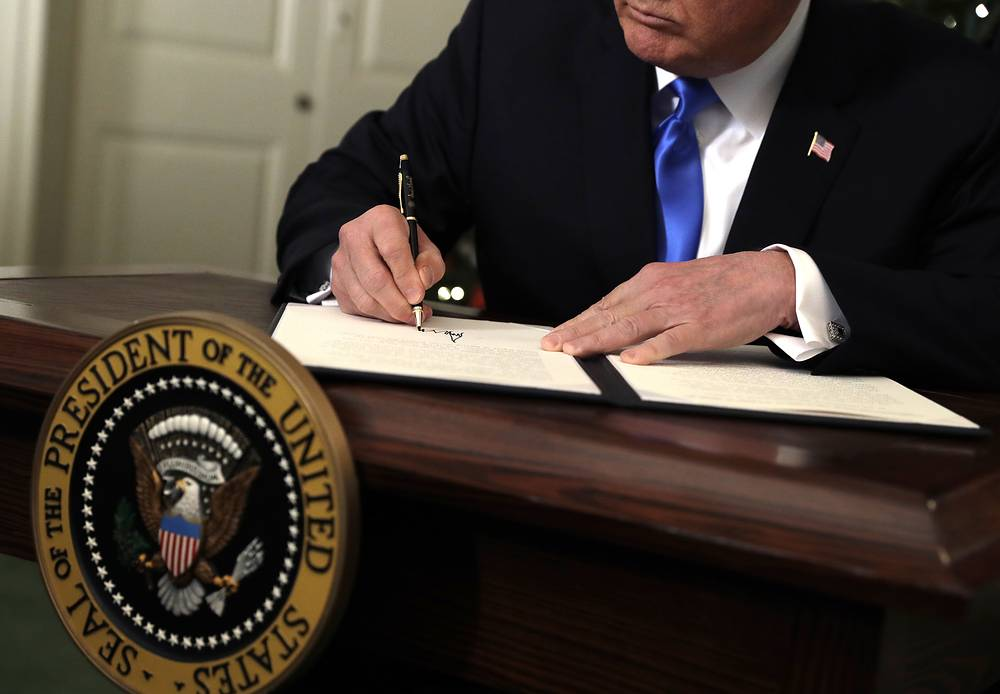 US President Donald Trump signs a proclamation to recognize Jerusalem as the capital of Israel in the Diplomatic Reception Room of the White House, Washington, USA, December 6