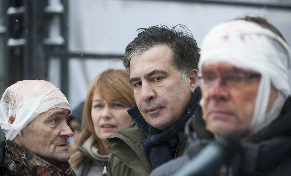 Former Georgian president and Ukraine's top opposition politician, Mikheil Saakashvili speaks to people wounded during clashes with police in Kiev, Ukraine, December 6. Police tried to take Saakashvili into custody at the tent camp, but his supporters put up fierce resistance to the officers