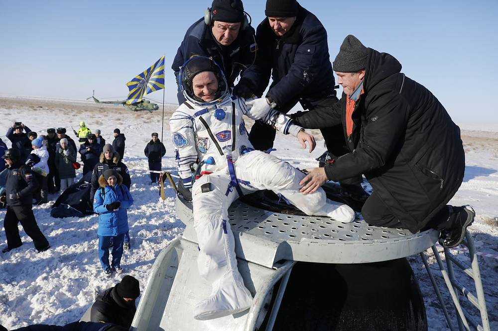 Russian space agency specialists help Russian cosmonaut Sergey Ryazanskiy shortly after the landing of the Russian Soyuz MS-05 space capsule about 150 km south-east of the Kazakh town of Zhezkazgan, Kazakhstan, December 14