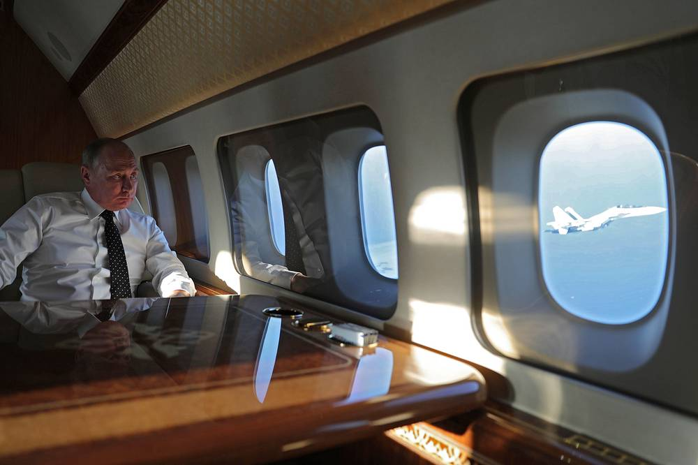 Russian President Vladimir Putin onboard a flight to Russia's Hmeymim airbase in Syria. Putin later ordered Russian troops to start pulling out of Syria, December 11