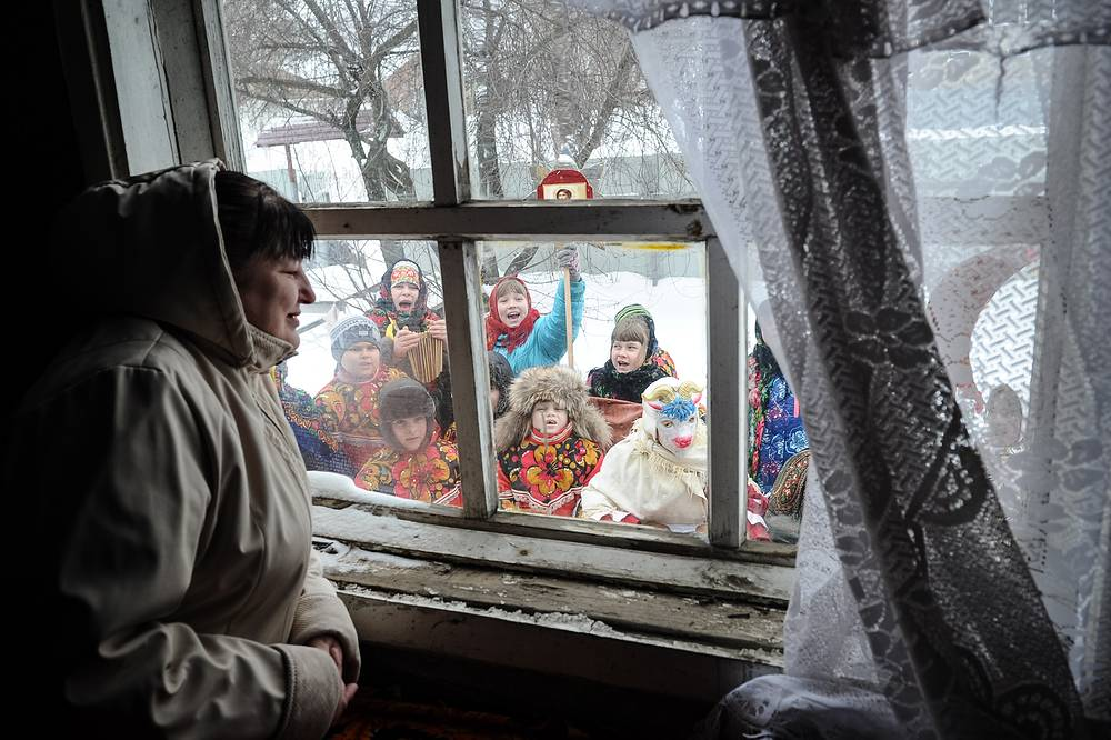 Traditional Christmas carolling in the village of Naumovo, Russia