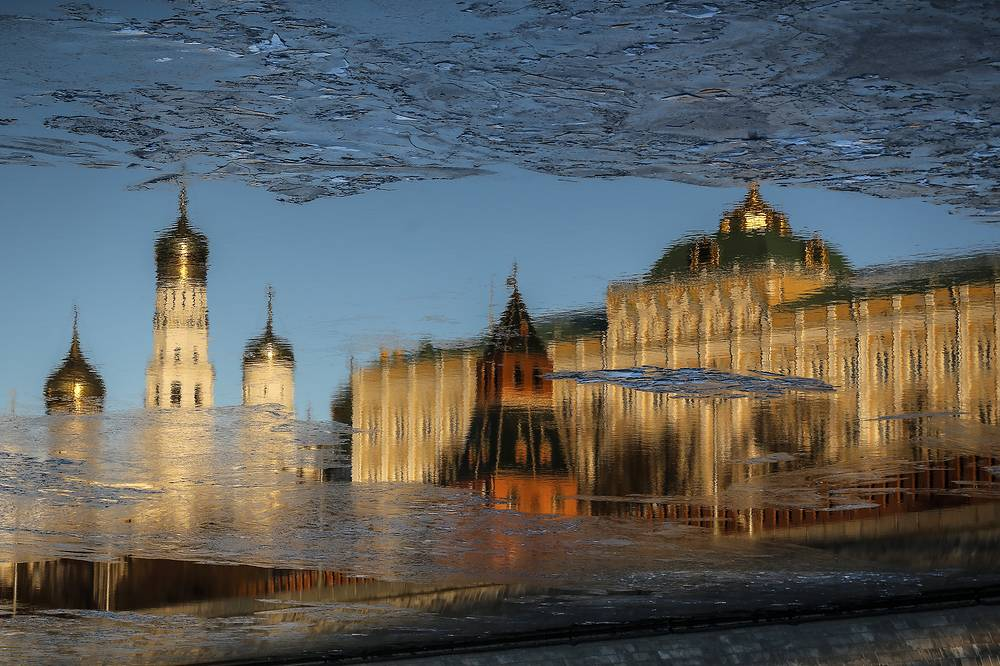 The Moscow Kremlin's Ivan the Great Bell Tower reflected in the Moskva River, Moscow, Russia, January 10