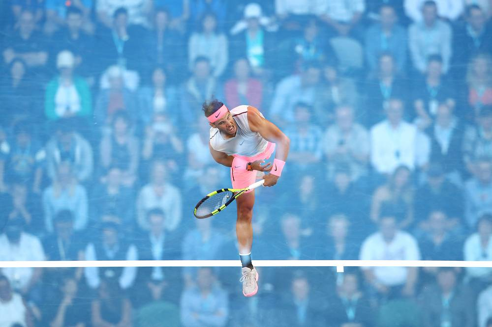 Rafael Nadal of Spain serves during his first round match against Victor Estrella Burgos of Dominican Republic on day one of the 2018 Australian Open at Melbourne Park, Australia, January 15