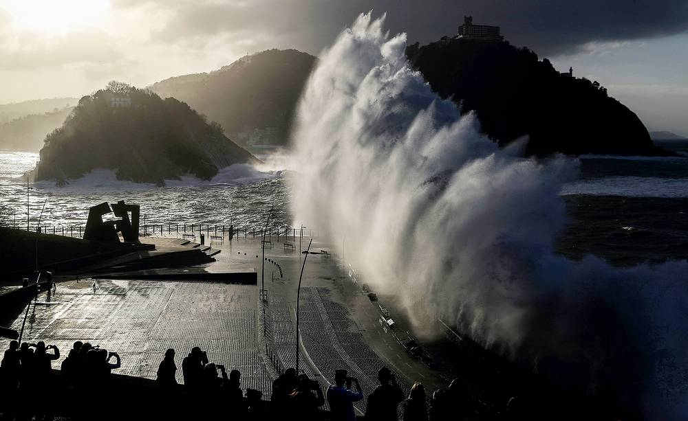 A huge wave crashes against the new promenade of San Sebastian, in the Basque Country, Spain, January 18
