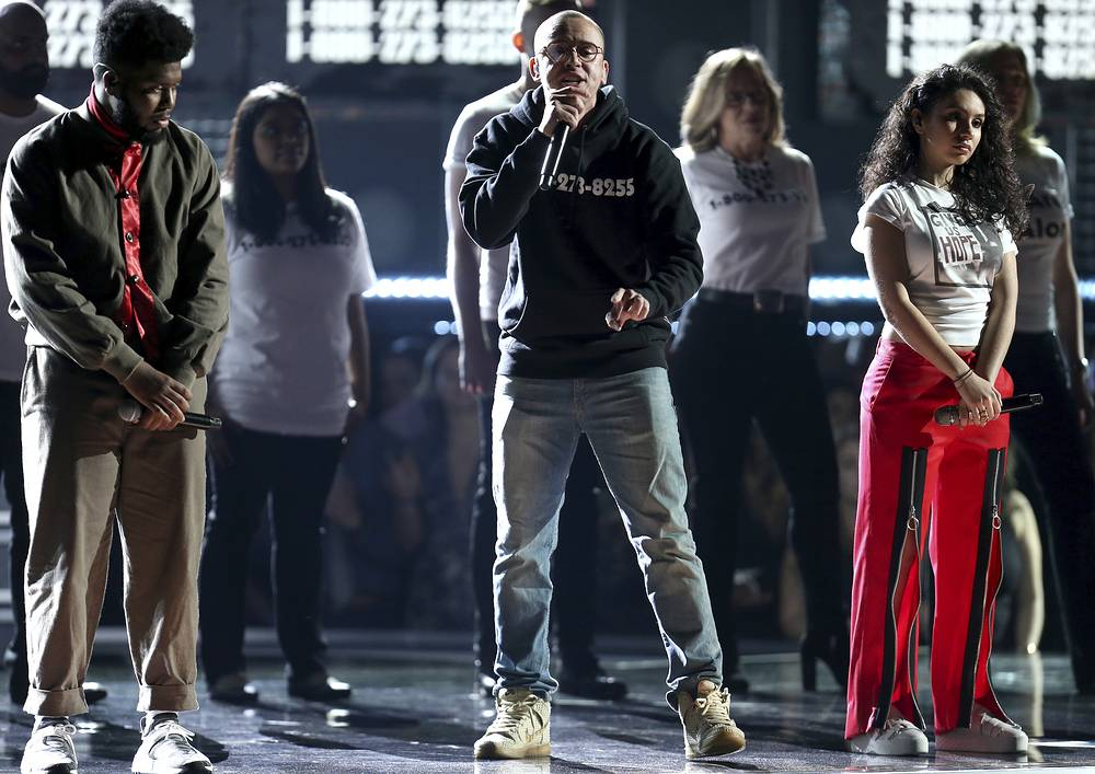 """Khalid, Logic, and Alessia Cara perform """"1-800-273-8255"""" as they are accompanied on stage with individuals affected by suicide"""