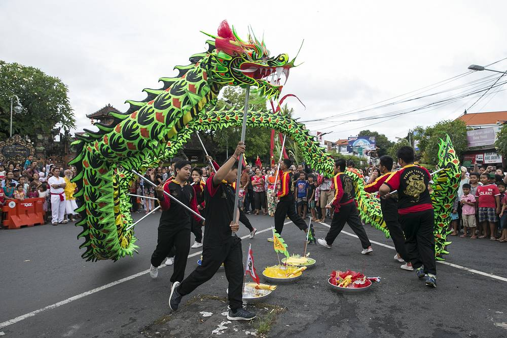 A group of dancers perform 'Liong' or dragon dance during the Chinese Lunar New Year celebrations at a temple in Kuta, Bali, Indonesia