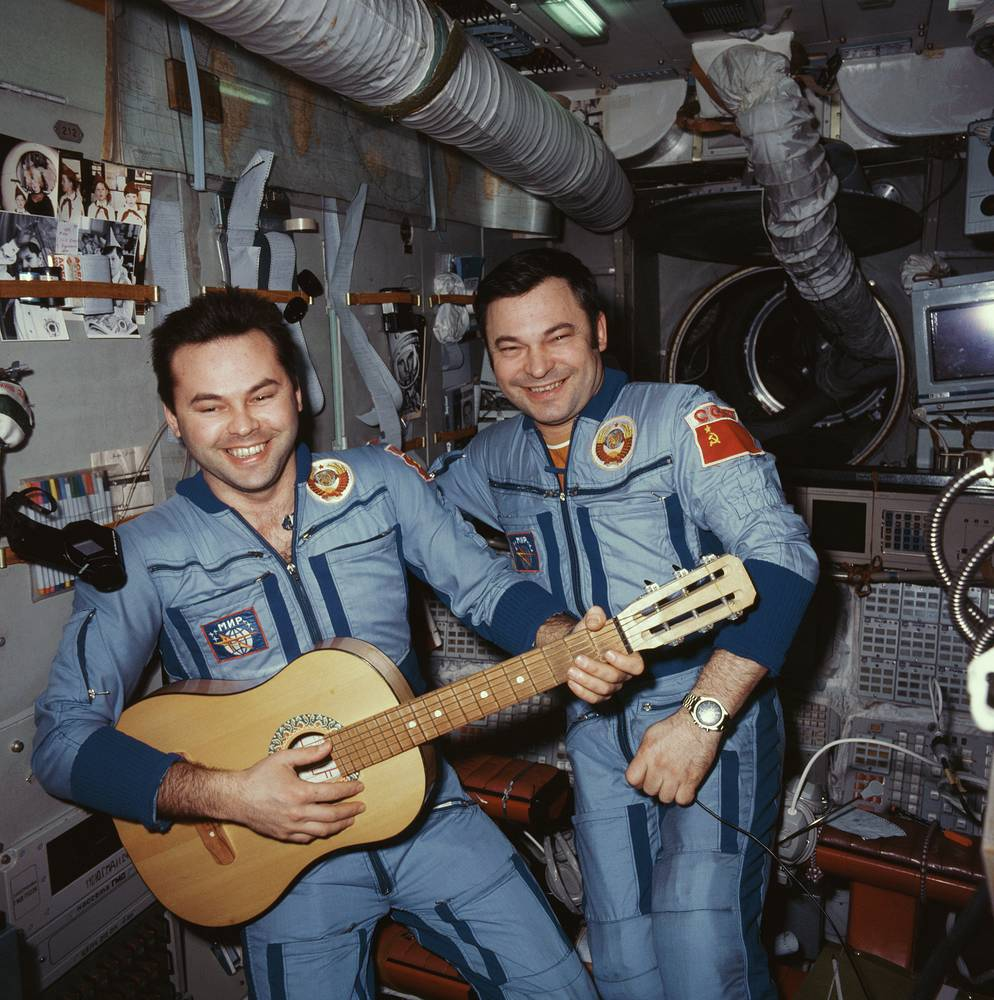 Mir was the first continuously inhabited long-term research station in orbit and held the record for the longest continuous human presence in space at 3,644 days, until it was surpassed by the ISS on 23 October 2010. Photo: Cosmonauts Yuri Romanenko and Alexander Viktorenko playing the guitar onboard the Mir space station, 1987