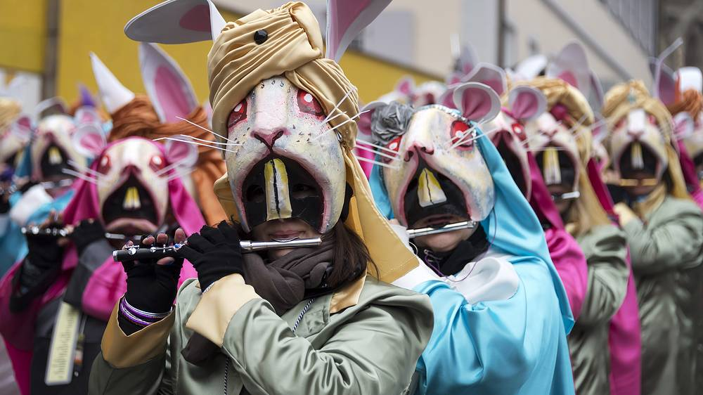 Revellers participate in a carnival procession in Basel, Switzerland, February 19