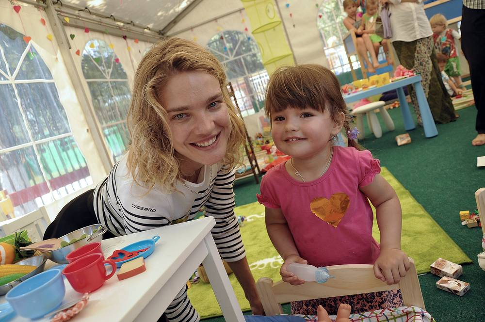 Vodianova's Naked Heart Foundation strives to provide a safe environment for every child living in urban Russia and to help support families raising children with disabilities. Photo: Natalia Vodianova in a Children's Play Tent set up by her Naked Heart Foundation in the flood-hit town of Krymsk