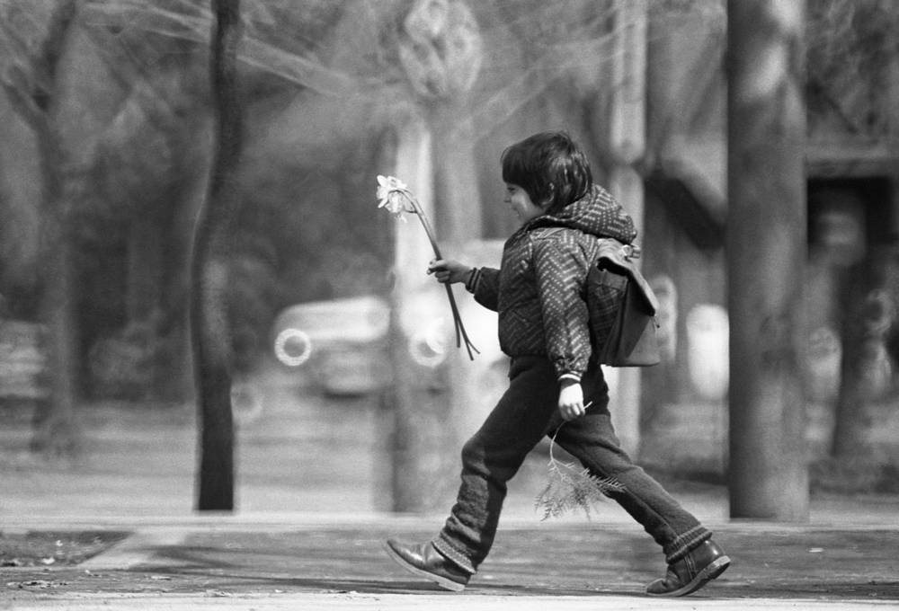 A child with a flower in the street of Yerevan, Armenian SSR, 1986