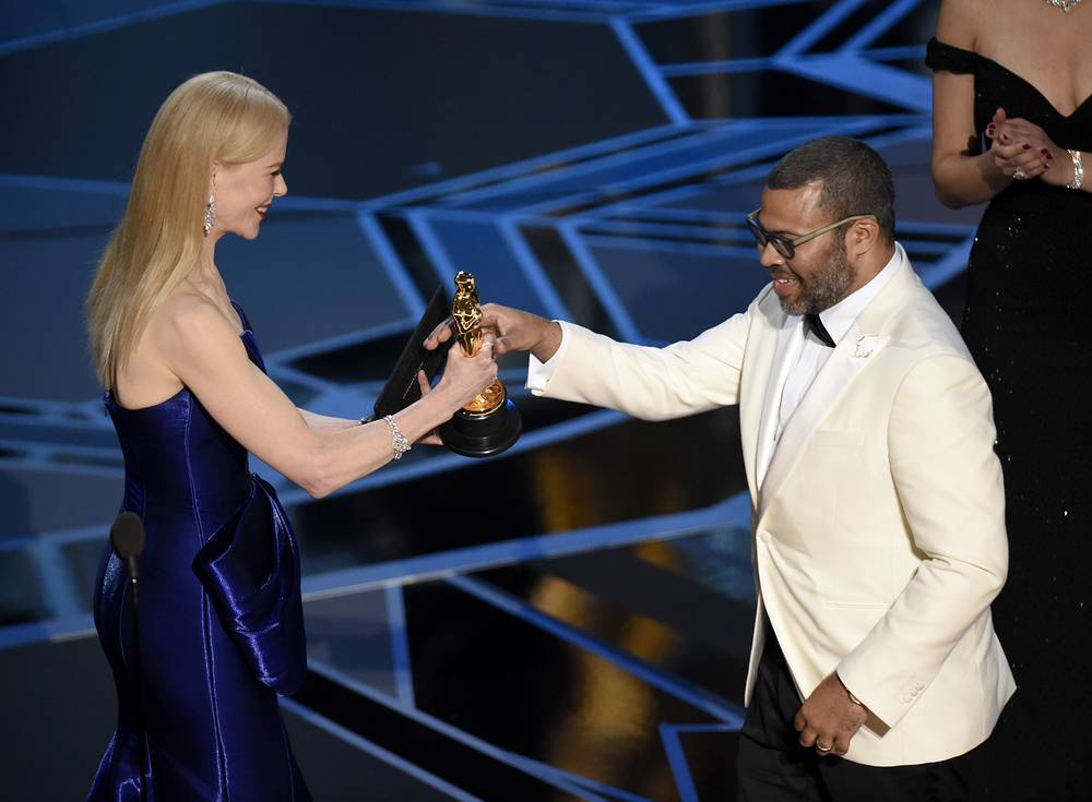 "Nicole Kidman presents Jordan Peele with the award for best original screenplay for ""Get Out"""