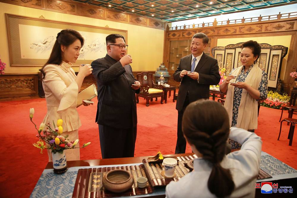 North Korean leader Kim Jong-un and his wife Ri Sol-ju meeting with Chinese President Xi Jinping and his wife Peng Liyuan as they visit the Diaoyutai State Guesthouse in Beijing, China, 28 March